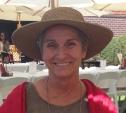 Susan headshot with hat